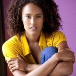 Kaneza Schaal (headshot new yellow)